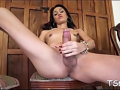 Tranny with large rod plays a solo