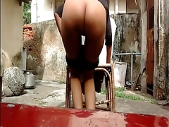 Very horny indian girl showing her assets outside home
