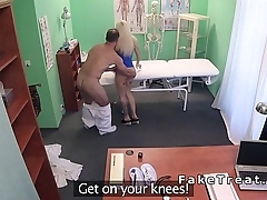 Doctor helping petite blonde patient to giving sample