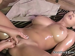 Huge tits brunette lesbo getting X-rated massage
