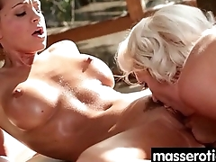 Gorgeous masseuse explores the body of a sexy lesbian beauty 18