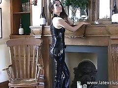 Shiny black latex device and fetishwear of sexy cougar Olivia posing in tight pl